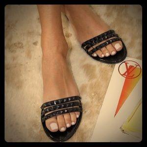 Black studded jelly flat sandals